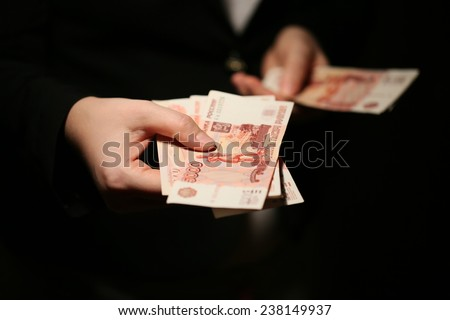 Close-up of a women hands counting Russian banknotes - stock photo