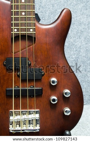 close up of a wooden bass with four volume controller - stock photo