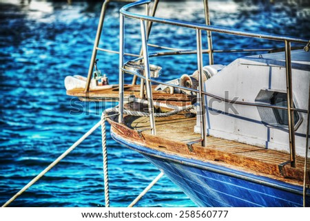 close up of a wooden boat moored in Alghero. Processed for hdr tone mapping effect - stock photo