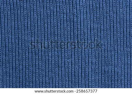 Close-up of a woolen pattern - detail of plain knitting - stock photo