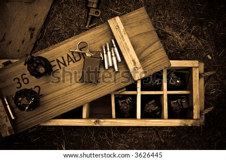 Close up of a WW II munitions box showing grenades and bullets - stock photo