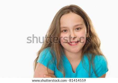close-up of a 10 year old girl smiling at the camera - stock photo