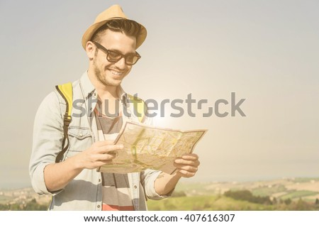 Close up of a Young boy as he reads the map, traveling alone - lifestyle,people, outdoor and Holiday concept - stock photo