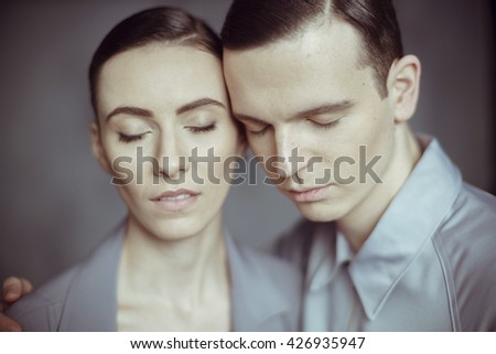 Close up of a young couple with closed eyes - stock photo