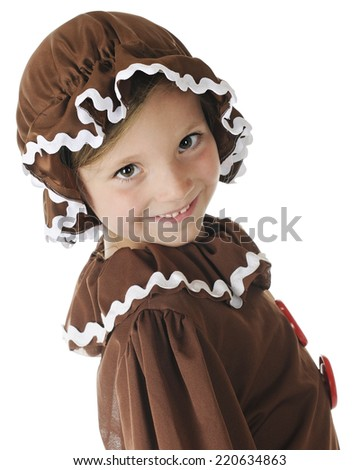 """Close up of a young elementary """"gingerbread girl"""" smiling at the viewer.  On a white background. - stock photo"""