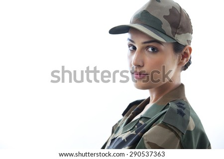 Close-up of a young female soldier - stock photo