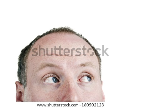Close-up of a young man looking up at corner - stock photo