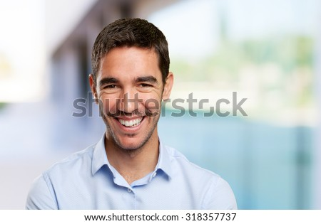 Close up of a young man smiling - stock photo