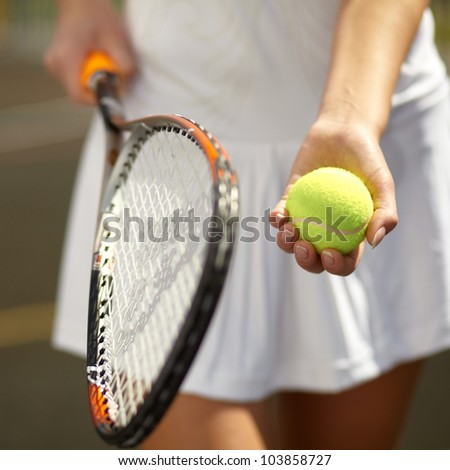 Close up of a young tennis player standing ready for a serve - stock photo