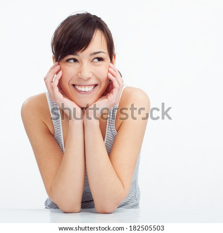 Close-up of a young woman smiling and looking to the side. Copy space. - stock photo