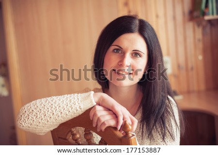 Close-up of a young woman smiling, brunette - stock photo