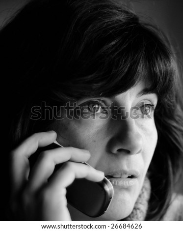 Close up of a young woman talking on the phone. - stock photo