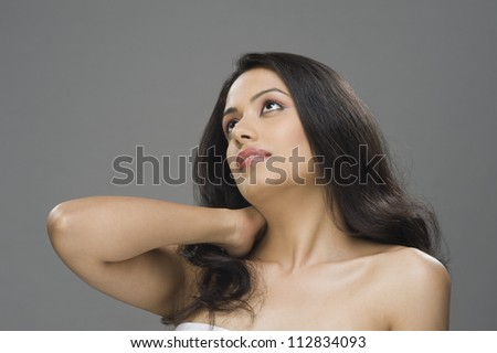 Close-up of a young woman thinking - stock photo