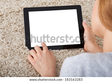 Close-up Of A Young Woman Using Digital Tablet - stock photo