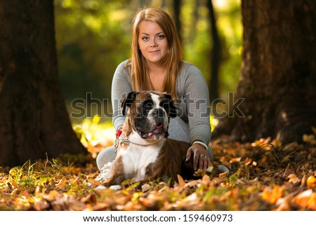 Close-Up Of A Young Women With Her Dog - stock photo