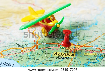 Close up of  Adana ,Turkey  map with red pin  and airplane   - Travel concept - stock photo