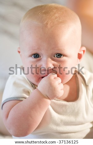 Close up of adorable chubby seven month old baby - stock photo