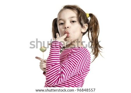 Close-up of adorable little girl with a lollipop, isolated on white background - stock photo