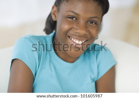 Close up of African girl smiling - stock photo