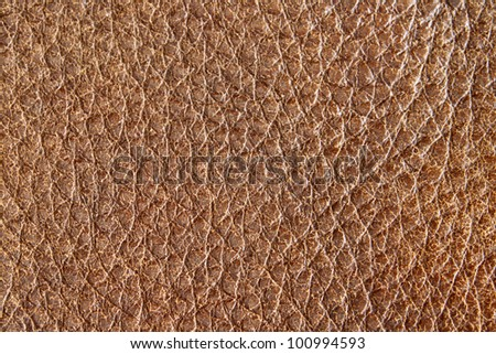 Close up of aged brown leather grain. - stock photo