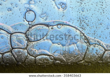 close up of air balls in blue water  - stock photo