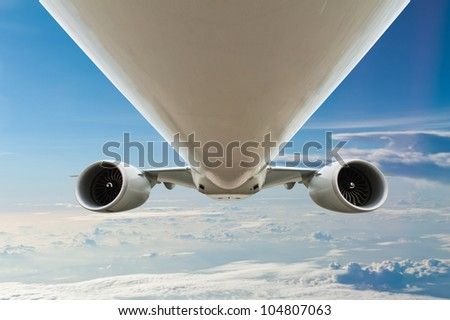 Close-up of airplane in the sky - stock photo