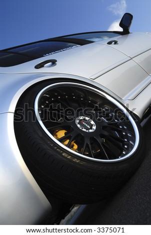 Close up of alloy wheel - stock photo