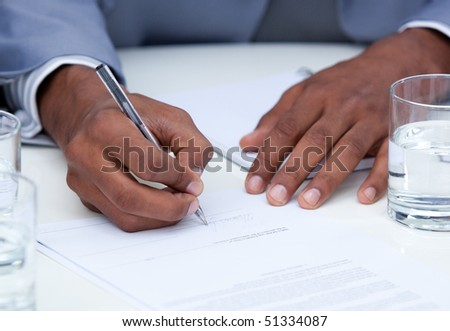 Close-up of ambitious business man signing a contract in a company - stock photo