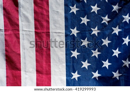 close up of american flag in sunshine, half stars, half stripes. - stock photo