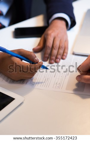 Close-up Of An African Businessperson Signing Contract - stock photo