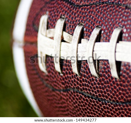 Close up of an american football against a black background - stock photo