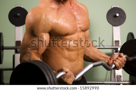 Close-up of an anonymous athletic man lifting weights - stock photo