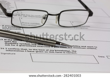 Close up of an application form to be completed - stock photo