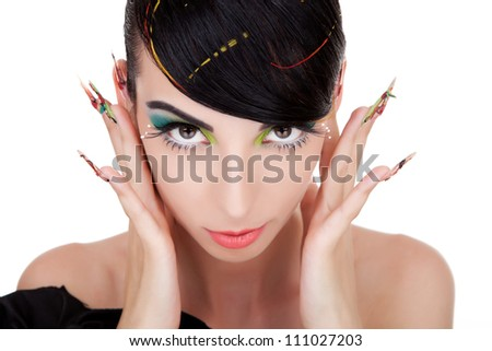 Close-up of an attractive woman holding her fingers in her ears and watching the camera. Isolated on white background. - stock photo