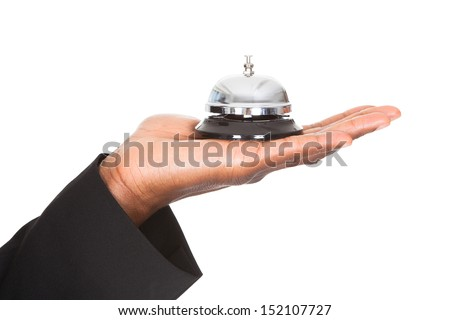 Close-up Of An Businessman Hand Holding A Service Bell Isolated Over White Background - stock photo