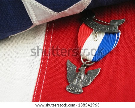 Close up of an Eagle Scout Award sitting on a Flag - stock photo