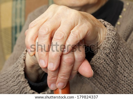 Close up of an elderly crossed hand - stock photo