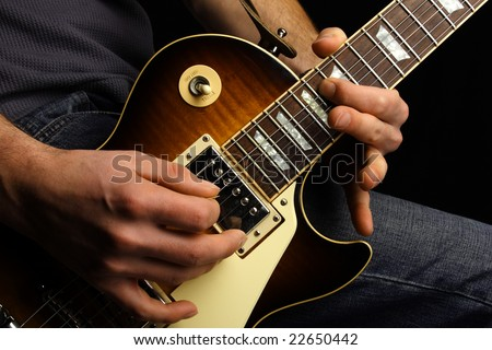Close up of an electric guitar being played. - stock photo