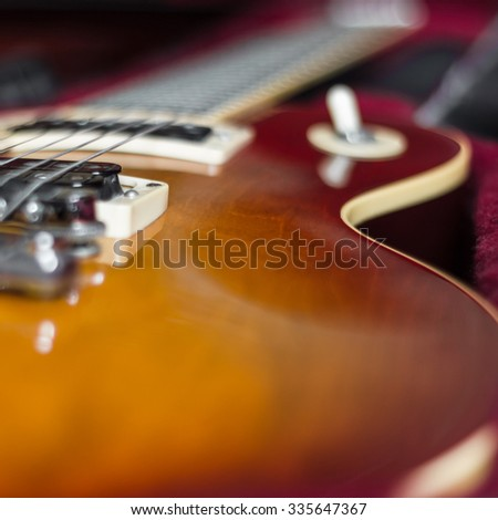 Close-up of an electric guitar in its carry case. - stock photo