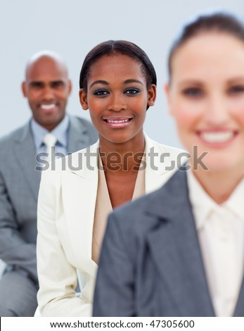Close-up of an ethnic manager and her team  standing - stock photo