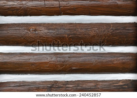 Close up of an Exterior Log Cabin Wall with Chinking - stock photo