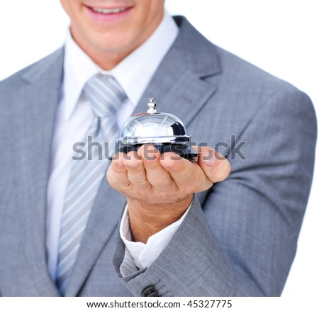 Close-up of an happy businessman holding a service bell at the hotel - stock photo