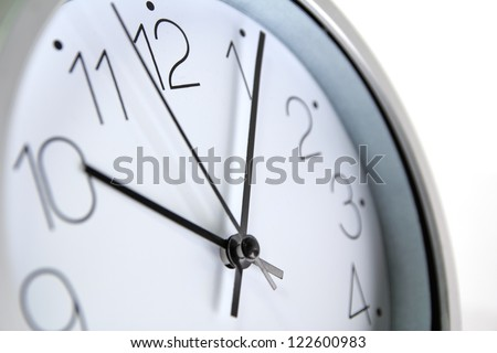 close up of an office clock - stock photo