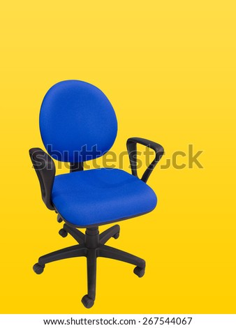 Close-up of an office swivel chair isolated against yellow background - stock photo