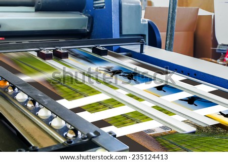 Close up of an offset printing machine during production - stock photo