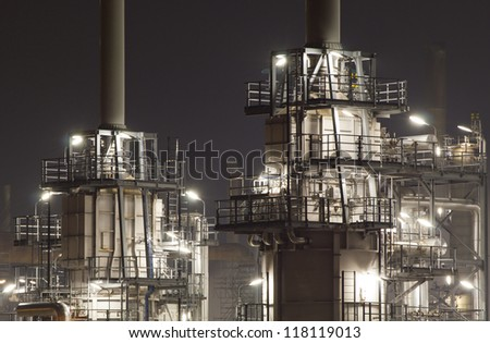 Close-up of an oil-refinery plant at night - stock photo