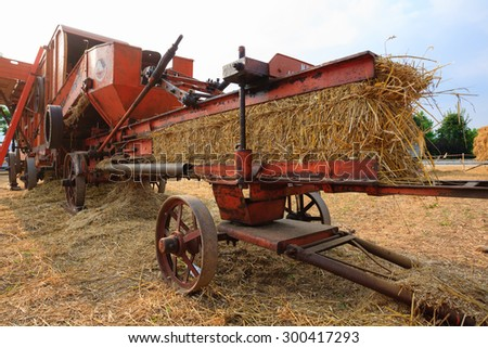 Close up of an old agricultural vehicle for packing straw, rural life - stock photo
