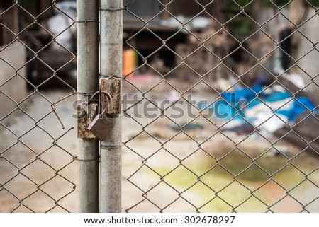 Close up of an old lock and a rusty chain on an iron gate - stock photo