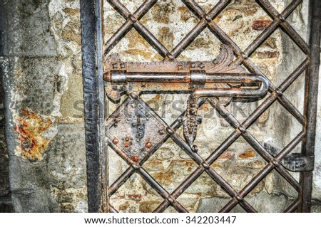close up of an old metal deadbolt in hdr - stock photo