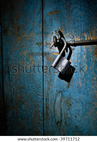Close-up of an old padlock - stock photo